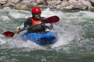 Erik Weihenmayer shooting the Colorado River Rapids